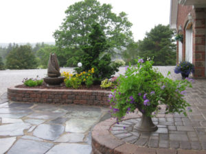 Flagstone patio with raised garden.